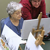 Beverly: Nancy Bouchard , 56, was diagnosed with alzheimerss. She's very self aware and does a lot of talking about the illness. Here, she helps Teresa Perry with her artwork, where She volunteers at Spectrum  Adult Care Day Center. Photo by Mark Lorenz/Salem News <br /> , Beverly: Nancy Bouchard , 56, was diagnosed with alzheimerss. She's very self aware and does a lot of talking about the illness. Here, she helps Teresa Perry with her artwork, where She volunteers at Spectrum  Adult Care Day Center. Photo by Mark Lorenz/Salem News