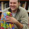 Danvers:<br /> Scott Buchanan, broker/coordinator at the Northeast Arc's Autism Support Center, holds a scarf which symbolizes autism awareness.<br /> Photo by Ken Yuszkus/Salem News, Tuesday, March 9, 2010.