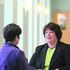 Salem:<br /> Christine Sullivan, Executive Director of the Enterprise Center, speaks with Cathy Julien ( who has her back to the camera ).<br /> Photo by Ken Yuszkus/Salem News, Monday March 9, 2009.