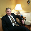 Salem: Joseph Gibbons, President and CEO of Salme Five Cents Savings Bank, sits on the couch in his office at the bank on Essex Street.  <br /> Photo by Kristen Olson/Salem News. Wednesday, January 11, 2006