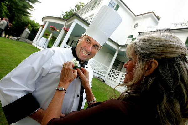 Danvers: Owner of Henry's Market, John Keohane, is pinned by Anna Bertini, co-chair of the Danvers Family Festival Champagne Gala, during last night's event held at the Glen Magna Estate. <br /> Photo by Deborah Parker/Salem News Friday, June 20, 2008
