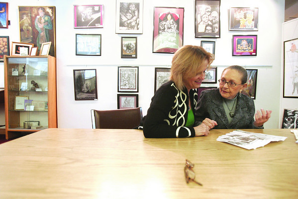 Mary kiley, a Hebrew Scripture teacher at St. Johns Prep, who works with  Sonia Weitz as a Holocaust Legacy partner, look through clippings at the Holocaust Center.