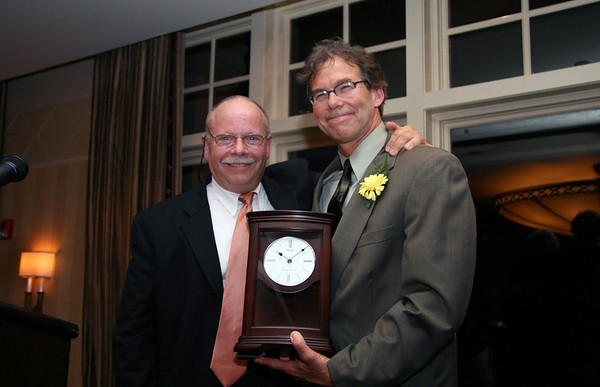 Stephen Schaffer, former Executive Director of Children's Friend and Family Services (l) presents Reverend Michael J. Duda, Senior Pastor at the First Church of Wenham, with Children's Friend and Family Services Champion for Children award. Over 150 people attended the Champion for Children Celebration held at Kernwood Country Club to honor Duda's contribution to children in Essex County. The annual Champion for Children award acknowledges the tremendous accomplishments of an individual in his/her professional and personal life-achievements that reflect Children's Friend and Family's core values of making a lasting difference in the improvement of lives of children and families. Richard J. Holbrook Chairman and CEO of Eastern Bank was honored with the award last year and Charlie Baker, President and CEO of Harvard Community Health Plan, was named the first recipient of the Champion for Children award.<br /> , Stephen Schaffer, former Executive Director of Children's Friend and Family Services (l) presents Reverend Michael J. Duda, Senior Pastor at the First Church of Wenham, with Children's Friend and Family Services Champion for Children award. Over 150 people attended the Champion for Children Celebration held at Kernwood Country Club to honor Duda's contribution to children in Essex County. The annual Champion for Children award acknowledges the tremendous accomplishments of an individual in his/her professional and personal life-achievements that reflect Children's Friend and Family's core values of making a lasting difference in the improvement of lives of children and families. Richard J. Holbrook Chairman and CEO of Eastern Bank was honored with the award last year and Charlie Baker, President and CEO of Harvard Community Health Plan, was named the first recipient of the Champion for Children award.