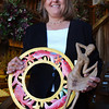 Newbury: <br /> Gale Hull holds craft items she brought back from a previous trip to Haiti.<br /> Photo by Bryan Eaton/Newburyport Daily News. Thursday, February 26, 2004