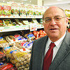 Salem:<br /> Jim Crosby of Crosby's Market stands in his Salem store (or) speaks with Tim Melvin, associate.<br /> Photo by Ken Yuszkus/Salem News, Friday March 6, 2009.
