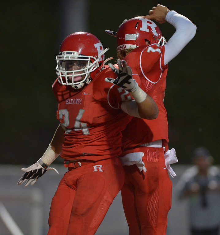 . 0831_SPT_TDB-L-NORTHREDONDO --Redondo Beach, California - - Staff Photo: Robert Casillas / LANG -- North Torrance at Redondo Union HS football season opener. Jamaal Perkins 24 celebrates his TD with QB Harrison Faecher.