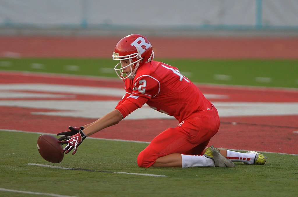 . 0831_SPT_TDB-L-NORTHREDONDO --Redondo Beach, California - - Staff Photo: Robert Casillas / LANG -- North Torrance at Redondo Union HS football season opener. Dominik Eberle scrambles for loose punt attempt.