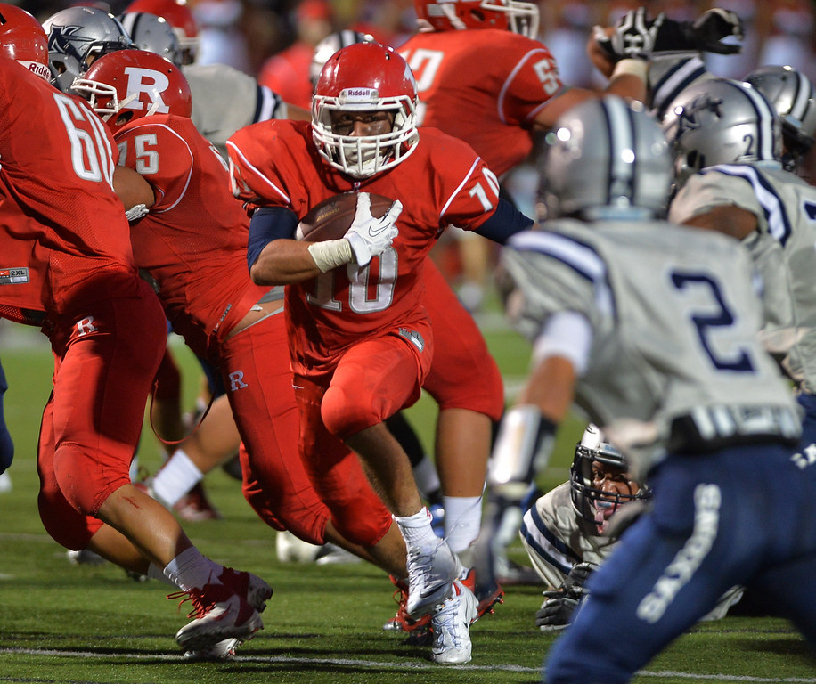 . 0831_SPT_TDB-L-NORTHREDONDO --Redondo Beach, California - - Staff Photo: Robert Casillas / LANG -- North Torrance at Redondo Union HS football season opener. Adam Basaca finds room to run for Redondo.
