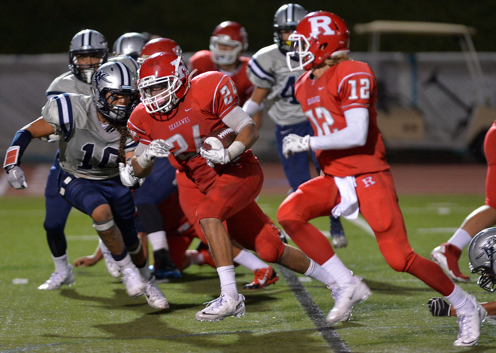 . 0831_SPT_TDB-L-NORTHREDONDO --Redondo Beach, California - - Staff Photo: Robert Casillas / LANG -- North Torrance at Redondo Union HS football season opener. Jamaal Perkins runs.