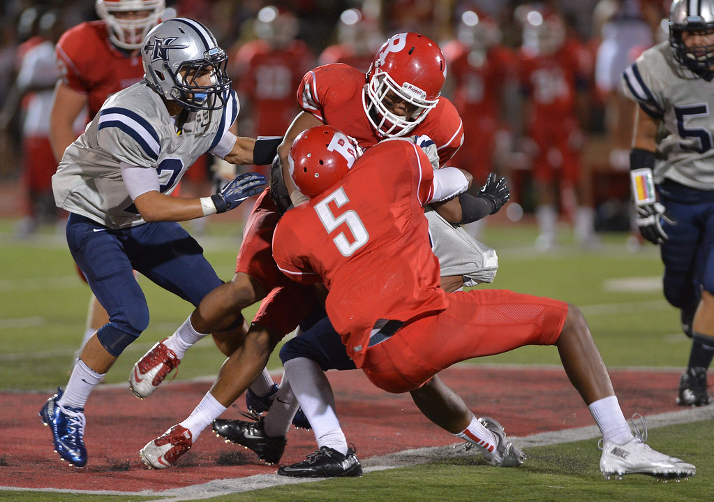 . 0831_SPT_TDB-L-NORTHREDONDO --Redondo Beach, California - - Staff Photo: Robert Casillas / LANG -- North Torrance at Redondo Union HS football season opener. North\'s Corey Cox is crushed between Redondo defenders Amir Crear 5 and Stephon Sudduth.