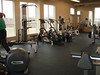 You can just see the end of the new rower as well as a new piece, the assisted pull up and dip machine. beside those some of the elipticals and hard to make it out but the new upright bike(it has a small TV screen on it) is there too.