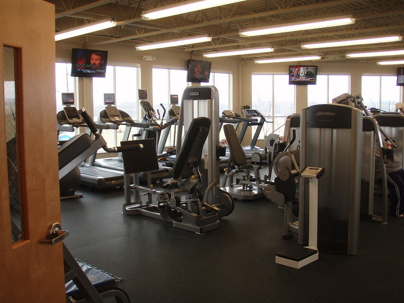 Well lighted with big windows all around with morotized blinds that can be lowered (by the staff). Walking in, along the outside walls is all the cardio stuff, Treadmills, ellipticals, recumbent bikes and one new upright bike as well as a new row machine. Then a line up of new weight machines.