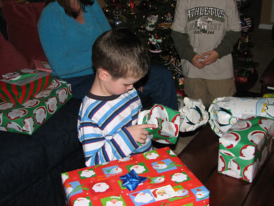 Tyler opens his annual Christmas ornament gift from Grannie and Grandpa.