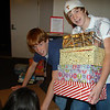Joel, Carter, and Abby volunteer to get shoeboxes for Operation Christmas Child ready