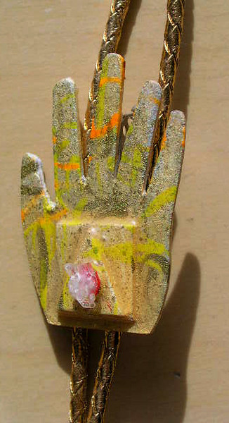 gold hand bolo