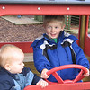 Eli driving a Tractor