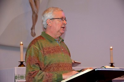 Fr. Maurice Légaré does a reading during Mass.
