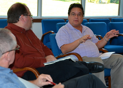 Fr. Paul Tennyson and Br. Duane Lemke listen to Fr. Jack Kurps during the meeting.