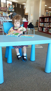 At the library.  Notice she picked out two identical Yo Gabba Gabba books from the bins of baby books