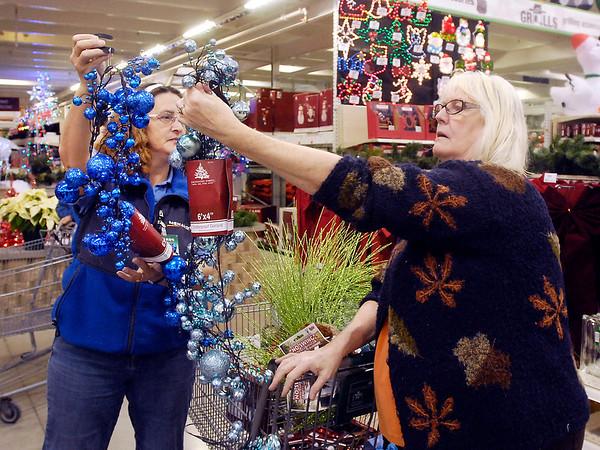 Shoppers at Menards for BIZ story.