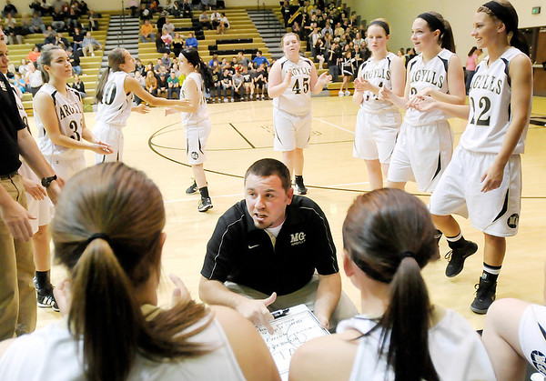 Don Knight/The Herald Bulletin<br /> Madison-Grant coach Chaz Barker talks to his starters as the Argylls are introduced during their game against Marion on Friday. Read about the game on today's B1.