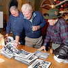 """Jim Bailey, Dan Forst, and William Amick get their first look at the book """"The Auto Industry of Madison County"""" at a reception Thursday evening at the Anderson Center for the Arts."""