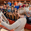 U.S. Rep. Susan Brooks looks over the framed picture collage that was presented to her from these Frankton Jr/Sr High School eighth graders Monday during her visit to the school.  The collage was made up of photos the students had taken during their trip last month to Washington D.C. during the government shutdown.  Rep. Brooks gave the students a personal tour of the Capital building during their visit.