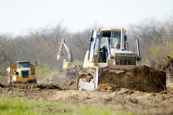 Don Knight/The Herald Bulletin<br /> Heavy equipment can be seen moving dirt at the Mallard Lake Landfill off County Road 300 East on Friday.