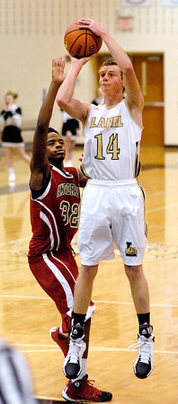 Lapel's Mitchell Richardson pulls up at the top of the key to shoot as Anderson's Greg Dixon tries to defend.