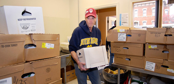 Rick Rchrer of the Christian Center carries in a case of milk as he helps unload a van-full of donated food from Hoosier Park Racing & Casino.  Hoosier Park gave the Christian Center 14 cases of turkeys, 9 cases of ham, 19 cases of milk, and 2 cases of eggs for their holiday feast.<br /> <br /> <br /> <br /> <br /> Hoosier Park Racing & Casino donating Thanksgiving food to Christian Center.