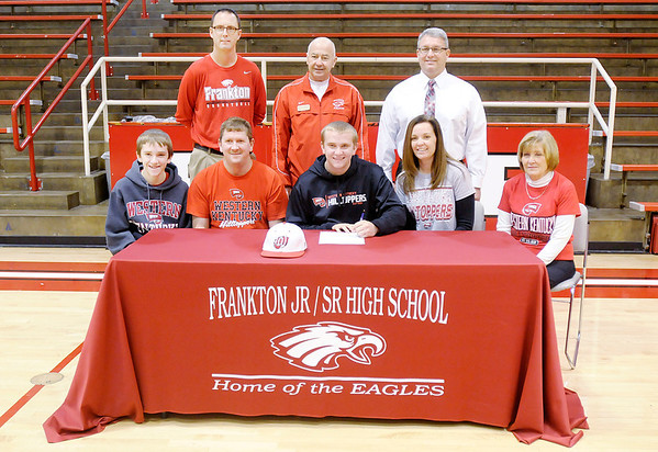 Don Knight/The Herald Bulletin<br /> Logan Weins signs his letters of intent to lay baseball at Western Kentucky at Frankton High School on Thursday. Seated from left are brother Landon Weins, dad Scott Weins, Logan Weins, mom Angie Weins and grandmother Carol Hudson. Standing from left are Assistant AD Brent Brobston, AD Phil Abernathy and Assistant Principal Jimmy Morehead.