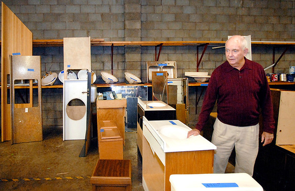 Karl Graddy, executive director of the Habitat for Humanity of Madison County, looks over some of the items they have for sale in their Resale Store lacated in their 8,000 square-foot headquarters at 800 East 19th Street in Anderson.
