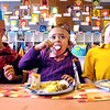 Zane Verhulst, Stephanie Arauz, and Levi Stonebarger all enjoy their Thanksgiving feast they had in Morgan Henson's Erskine Elementary kindergarten class Tuesday afternoon.  All the kindergarten classes dressed up as Pilgrims or Indians and sampled a variety of Thanksgiving foods.