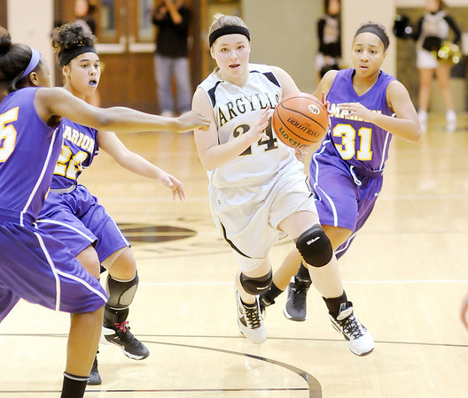 Don Knight/The Herald Bulletin<br /> Madison-Grant's Meagan Mooney drives into the lane as the Argyll's hosted the Marion Giants on Friday.