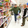 Don Knight / The Herald Bulletin<br /> Jeff and Christine Ballenger of New Castle shop for board games at Target in Anderson on Black Friday. Several stores are now offering holiday sales starting on Thursday.