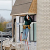 This construction worker works on the front overhang of the new Captain D's restaurant on Broadway in Anderson. Cody Dixon, general manager for Captain D's, said they are planning to reopen the first week of December waiting on windows and other final touches.