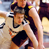 Nate Gross of AU and Mickey DeVries of Calvin College fight over a loose ball.