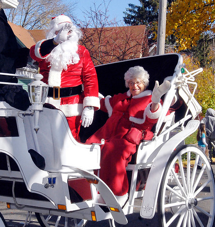 Santa and Mrs. Claus greet the crowds from this open carriage during the Christmas in Pendleton parade Saturday.