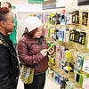 Don Knight / The Herald Bulletin<br /> From left, Alexis Warner and Jermani Milton look at cell phone cases at Target in Anderson on Black Friday. Several stores are now offering holiday sales starting on Thursday.