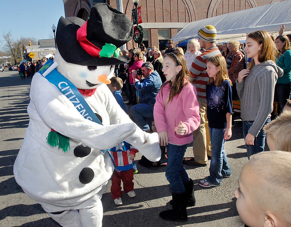 Frosty greeted the children along the parade route Saturday during the Christmas in Pendleton parade.