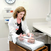 Don Knight/The Herald Bulletin<br /> Deidre Kettery, clinical manager of Community's New Generations Birthplace, evaluates a newborn at Community.