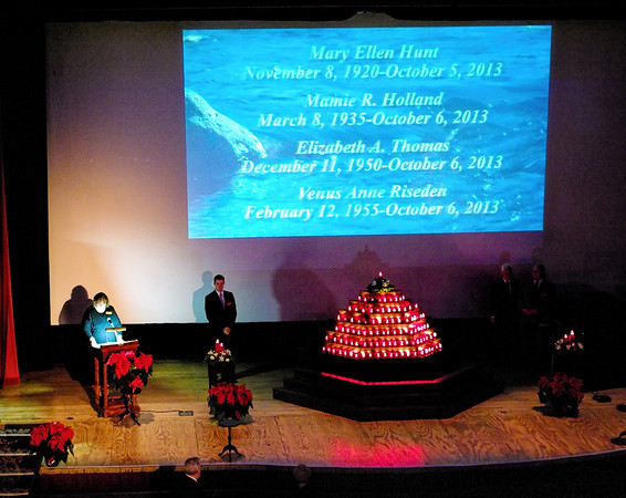 As each name is read during the annual Rememberance Service held at the Paramount Theatre on November 24, 2013, a candle is added to the tree.