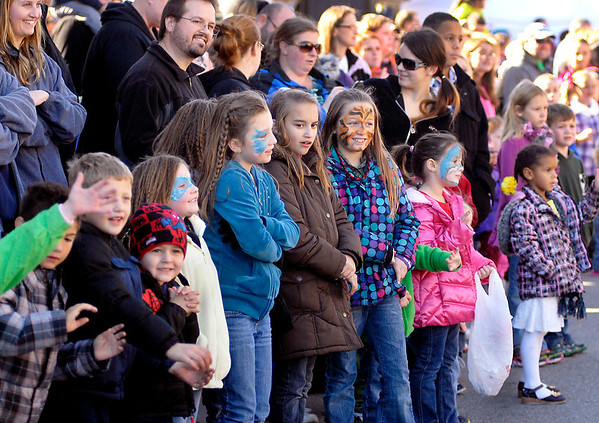 Children were lined up along the parade route eager to try to catch some of the candy being tossed out during the Christmas in Pendleton parade.