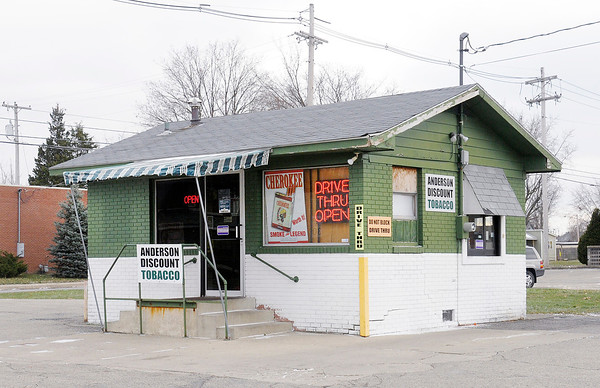 Don Knight/The Herald Bulletin<br /> Anderson Discount Tobacco located on 14th Street in Anderson. The property where the tobacco store is located is one of three parcels owned by the Anderson Township Trustee.