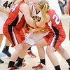 Don Knight / The Herald Bulletin<br /> From left, Kaylee Irwin, Morgan Tapscott and Ashtyn Rastetter fight for control of the ball as Shenandoah hosted Frankton on Friday.
