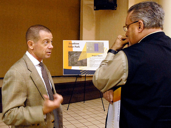 Tracy Barker, right, of Frankton, listens as Chris Rettig from the Indiana Municipal Power Agency explains the details of their proposed solar park during an open house this past Monday.  The park would include 4,000 solar panels on 8 acres of land on the south side of Frankton.