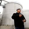 POET Biorefining general manager David Hudak stands in front of several of the large fermenting tanks used in the process of making ethanol at their Alexandria facility.