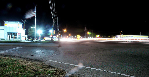 Don Knight/The Herald Bulletin<br /> Cars travel down Scatterfield Wednesday evening leaving a blur of lights in this long exposure. Ronald D. Carter, 25, of Anderson, was killed when he was struck by a car while crossing Scatterfield on Tuesday November 5th.