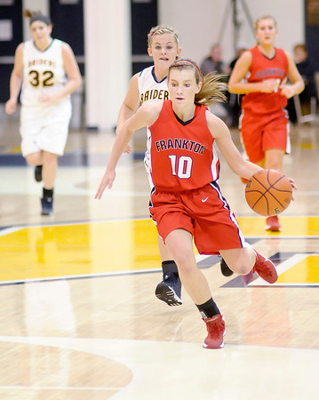 Don Knight / The Herald Bulletin<br /> Frankton's Emily Benefiel brings the ball downcourt on a fast break as the Shenandoah Raiders hosted the Eagles on Friday.