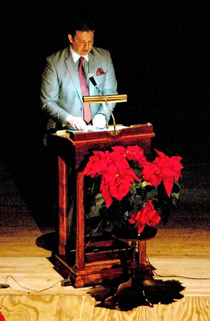 Pastor Luke St. Clair leads the Five Lights Ceremony during the annual Rememberance Service held at the Paramount Theatre on November 24, 2013.